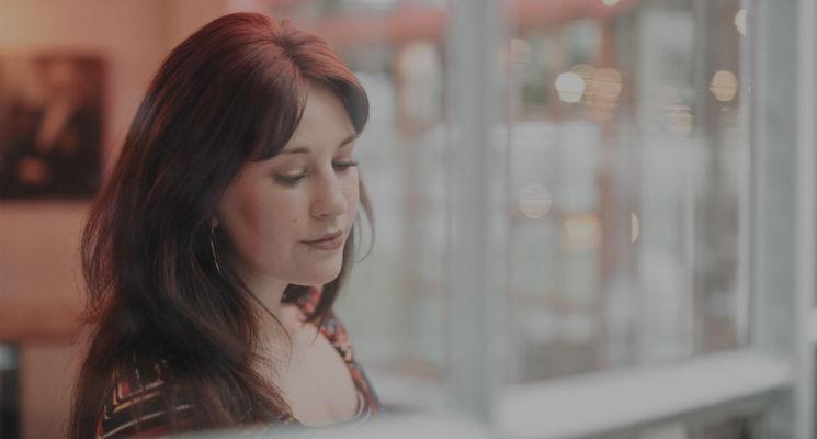 Annie Drury looks down through a window