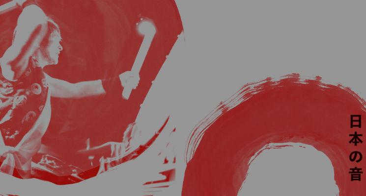 A man plays a taiko drum