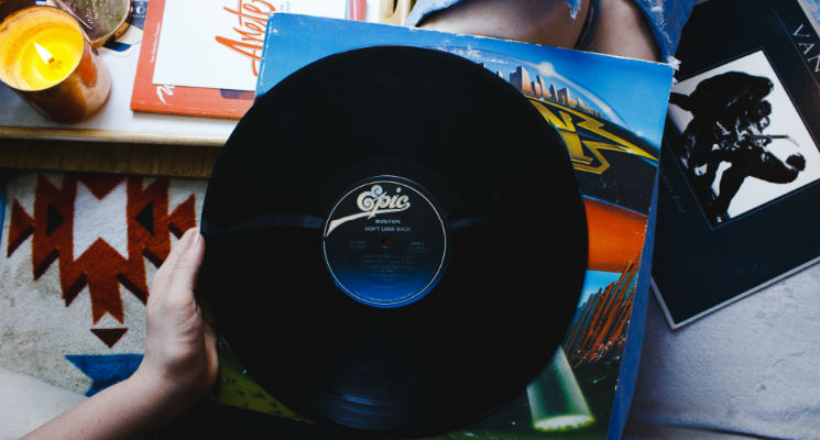 Vinyl record being held on someone's lap