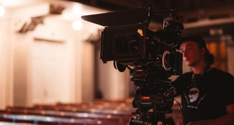 person filming in cinema best short films blog header