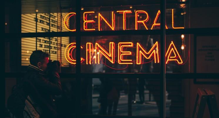cinema in neon lights in movie theatre window best selling movie soundtracks blog