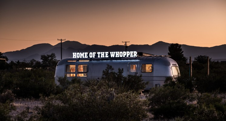 Burger King Home of The Whopper sign on caravan at sunset