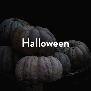 Pumpkins with white text reading 'Halloween'