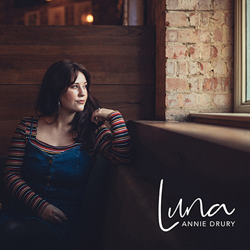 Album cover for Annie Drury's 'Luna'. Annie is pictured sitting down and staring out of a window