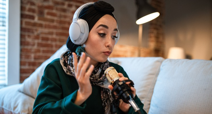 person recording a podcast with headphones on